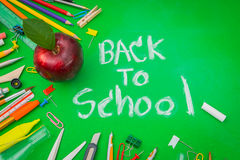 School supplies on Green chalkboard  Back to school background Stock Image