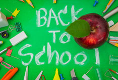 School supplies on Green chalkboard  Back to school background.  Royalty Free Stock Image