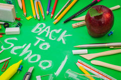 School supplies on Green chalkboard  Back to school background.  Royalty Free Stock Photo