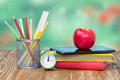 School supplies on green empty space background. Royalty Free Stock Photography