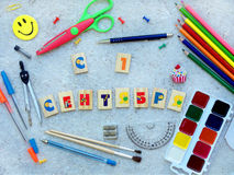 School supplies and  inscription congratulation on September 1 in Russian made up of cubes, showing back to school messageand open Stock Photos