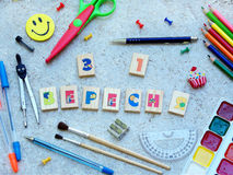School supplies and  inscription congratulation on September 1 in Ukrainian made up of cubes, showing back to school messageand op Stock Photo