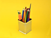 School Supplies Item in box on Yellow Background Stock Photos