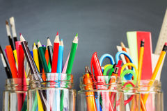 School supplies in jars Royalty Free Stock Photos