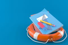 School supplies with life buoy. Isolated on blue background Royalty Free Stock Images