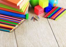 School supplies lying on the wooden floor Royalty Free Stock Photography