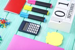 School supplies. On mint wooden table Stock Photos