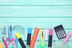 School supplies. On mint wooden table Royalty Free Stock Images