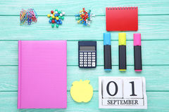 School supplies. On mint wooden table Royalty Free Stock Image