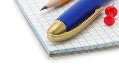 School supplies on notebook Royalty Free Stock Photography