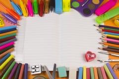 School supplies on notebook stock image
