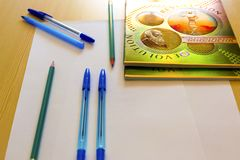 School supplies notebook pen pencils on the desk. stock photo