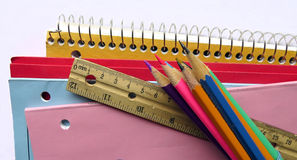 School supplies. Notebooks, duotangs, exercise books, pencil crayons and ruler, school supplies Stock Image