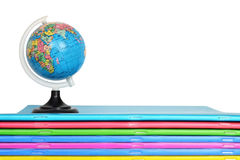 School supplies: Notebooks and globe isolated Royalty Free Stock Photos