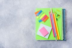 School supplies, notebooks pencils on grey background with copy space.  stock photography