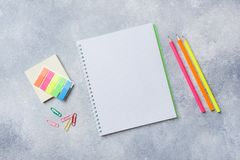 School supplies, notebooks pencils on grey background with copy space.  royalty free stock photo
