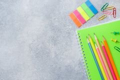 School supplies, notebooks pencils on grey background with copy space.  stock photos
