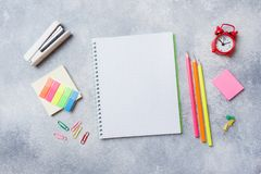School supplies, notebooks pencils on grey background with copy space.  royalty free stock photos