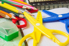 School supplies. Notebooks, pencils, pens, scissors lying on the table Royalty Free Stock Image