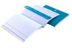 School supplies - notebooks, ruler. School supplies - notebooks, pen and blue ruler Stock Photos