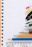 School supplies on notepad Stock Image