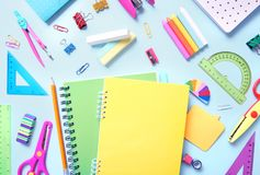School supplies,office equipment on blue background. School supplies on blue background top view,colorful office equipment,back to school royalty free stock photos