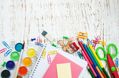 School supplies. On a old wooden background Royalty Free Stock Photos
