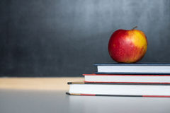 School supplies on old wooden table, near blackboard, close up Stock Photography