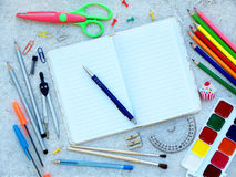 School supplies and open notebook with pen top border Stock Photo