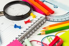 Close up of Colourful School Supplies on a White Table stock photo