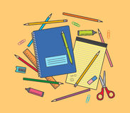 School supplies on orange background: notebook, pencils, pen, ruler, scissors, eraser, pencil sharpener, highlighter pen etc. Stock Images
