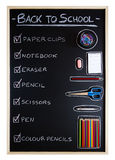 School supplies over blackboard background Stock Images