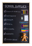 School supplies over blackboard background Royalty Free Stock Image