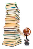 School supplies - books, ink and a globe on a white background Stock Image