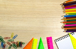 School supplies pencil, pen, ruler, triangle on blackboard bac Royalty Free Stock Photos