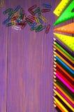 School supplies pencil, pen, ruler, triangle on blackboard bac Stock Photo