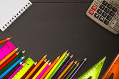 School supplies pencil, pen, ruler, triangle on blackboard bac Stock Images