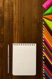 School supplies pencil, pen, ruler, triangle on blackboard bac Stock Images