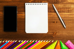School supplies pencil, pen, ruler, triangle on blackboard bac Stock Image