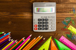 School supplies pencil, pen, ruler, triangle on blackboard bac Stock Photos