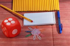 School supplies objects. School supplies pencils, notepad and paper clips Royalty Free Stock Photo