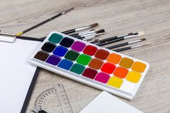 School supplies with pencils paint pens Stock Photography