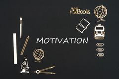 School supplies placed on black background with text motivation. Concept back to school, text motivation with school supplies chipboard miniatures placed on Stock Photography