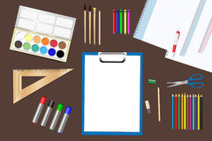 School supplies ready for use. School supplies are lying on a brown wooden table Royalty Free Stock Photo