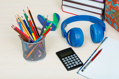 School supplies. School backpack, books, metal stand for pencils Stock Images