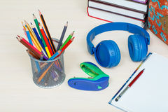 School supplies. School backpack, books, metal stand for pencils Stock Image