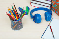 School supplies. School backpack, books, metal stand for pencils Royalty Free Stock Photo