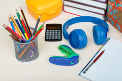 School supplies. School backpack, books, sandwich box, stand for Stock Photos
