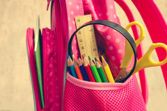 School supplies are in school backpack. Royalty Free Stock Photos