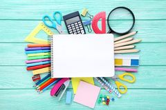 School supplies. With blank sheet of paper on wooden table stock image